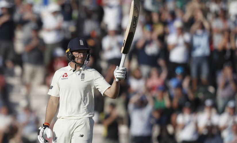 Jos Buttler raises his bat after bringing up his half-century on Day 3. AP