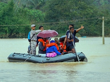A disaster management team rescues flood-hit people at Vithiri in Kerala's Wayanad in 2018. PTI
