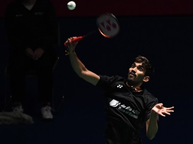 India's Srikanth Kidambi hits a return towards Hong Kong's Vincent Wong Wing Ki during their men's second round matches at the Japan Open badminton championships in Tokyo. AFP