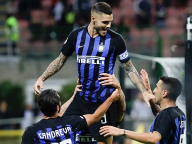 Inter Milan captain Mauro Icardi celebrates with teammates after scoring the opening goal against Fiorentina. AP