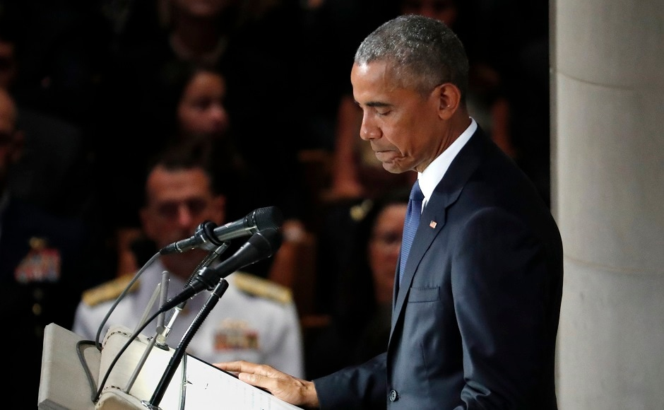 """Obama, in his eulogy, hailed the one-time prisoner of war for his commitment to truth and core democratic values. He said that he and McCain """"didn't advertise it,"""" but they would meet almost weekly in the Oval Office to talk about policy and also their families. AP"""