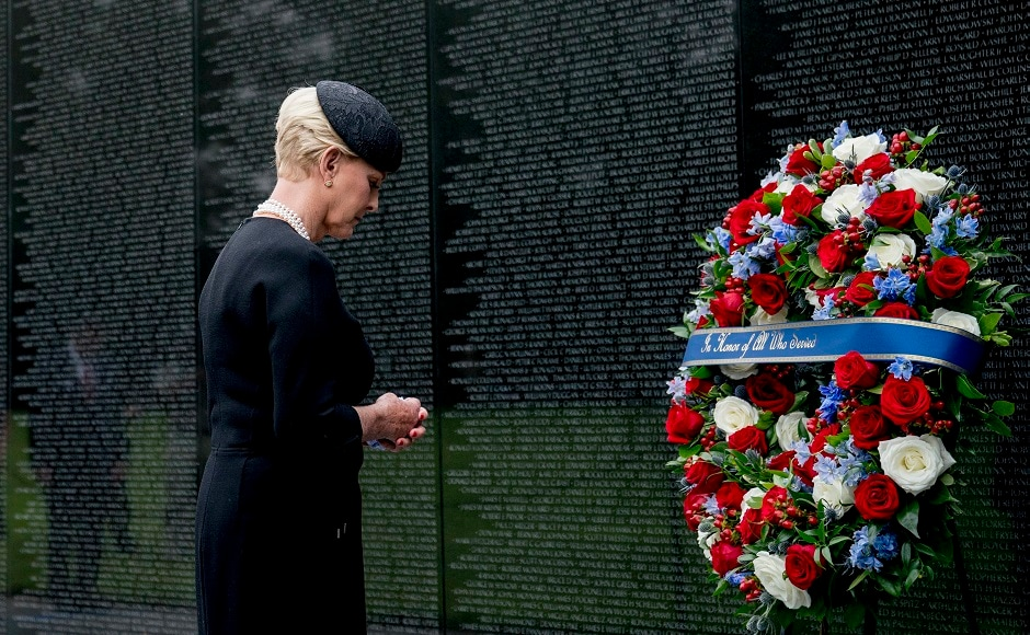 McCain's wife, Cindy, laid a wreath to honor those who died in the war at the Vietnam Veterans Memorial. AP