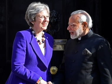 File image of Prime Minister Narendra Modi and Britain's prime minister Theresa May. Reuters