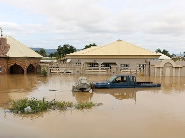 Houses submerged on a flooded street after a heavy downpour in Nigeria. AP