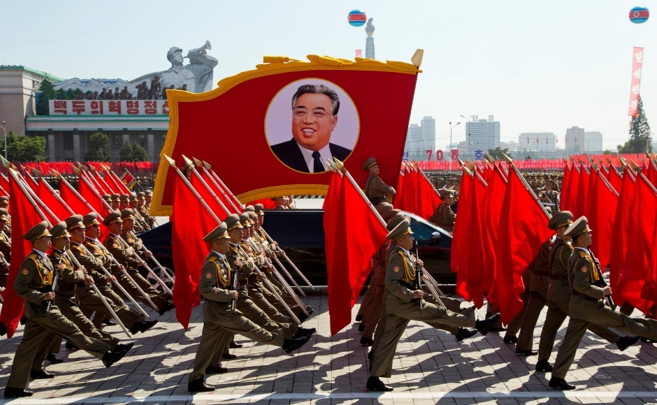 Soldiers march with a float showing late North Korean leader Kim Il Sung, Nearly half of the parade was devoted to civilian efforts to build the domestic economy. AP
