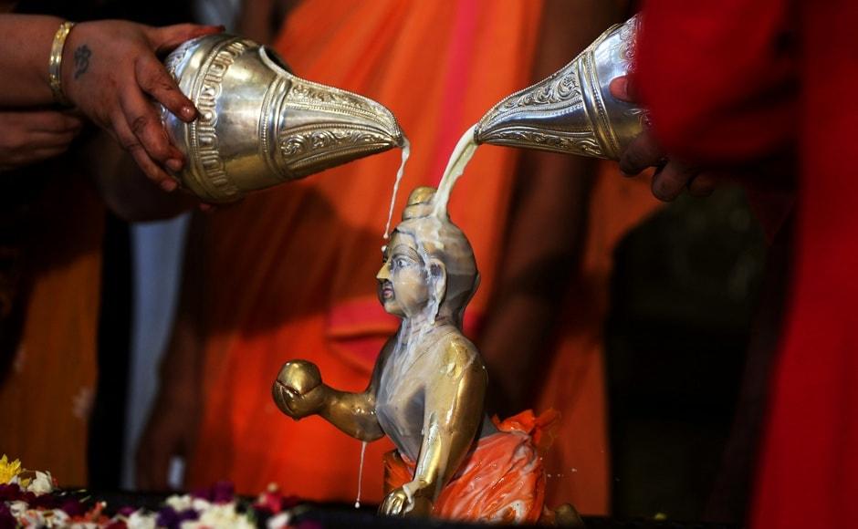 Janmashtami or Gokulashtami, is an annual Hindu festival that celebrates the birth of Lord Krishna, the eighth avatar of Lord Vishnu. Devotees pour milk over the idol of Lord Krishna at Ahmedabad in Gujarat. Reuters