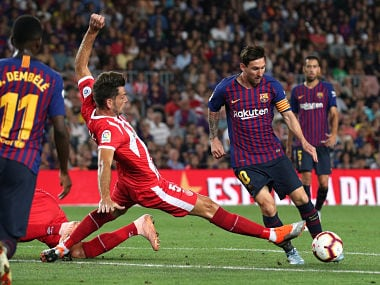 Barcelona's Lionel Messi in action with Girona's Pedro Alcala. Reuters