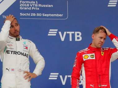 Formula One F1 - Russian Grand Prix - Sochi, Russia - September 30, 2018 Mercedes' Lewis Hamilton after winning the race alongside third placed Ferrari's Sebastian Vettel REUTERS/Maxim Shemetov - RC121C9D8EB0