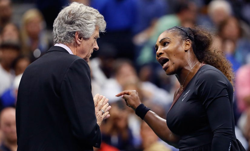Serena Williams discusses her penalty for code violation with referee Brian Earley during her match against Naomi Osaka in the 2018 US Open final. AP