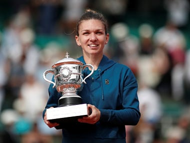 Tennis - French Open - Roland Garros, Paris, France - June 9, 2018 Romania's Simona Halep celebrates with the trophy after winning the final against Sloane Stephens of the U.S. REUTERS/Benoit Tessier - RC1648D03810