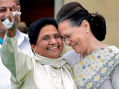Congress leader Sonia Gandhi and  Bahujan Samaj Party leader Mayawati during the swearing-in ceremony of JD(S)-Congress coalition government in Bengaluru. PTI
