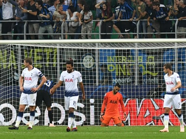 Tottenham players react after conceding a goal in their UEFA Champions League fixture against Inter Milan. AFP