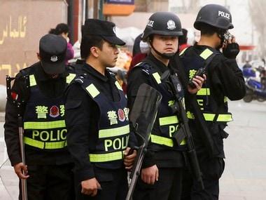 Fiel image of armed police keeping watch in a street in Kashgar, Xinjiang Uighur Autonomous Region, China. Reuters