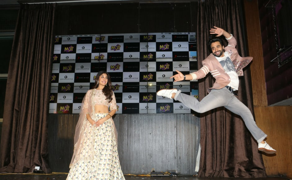 Kritika Kamra looks on as Jackky Bhagnani shows off his dance moves.