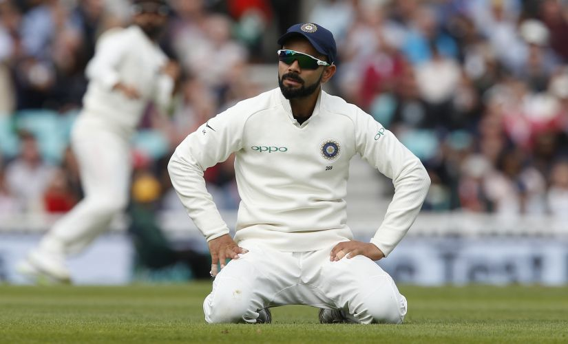 India's captain Virat Kohli reacts during play on the second day of the fifth Test cricket match between England and India at The Oval in London on September 8, 2018. / AFP PHOTO / Ian KINGTON / RESTRICTED TO EDITORIAL USE. NO ASSOCIATION WITH DIRECT COMPETITOR OF SPONSOR, PARTNER, OR SUPPLIER OF THE ECB