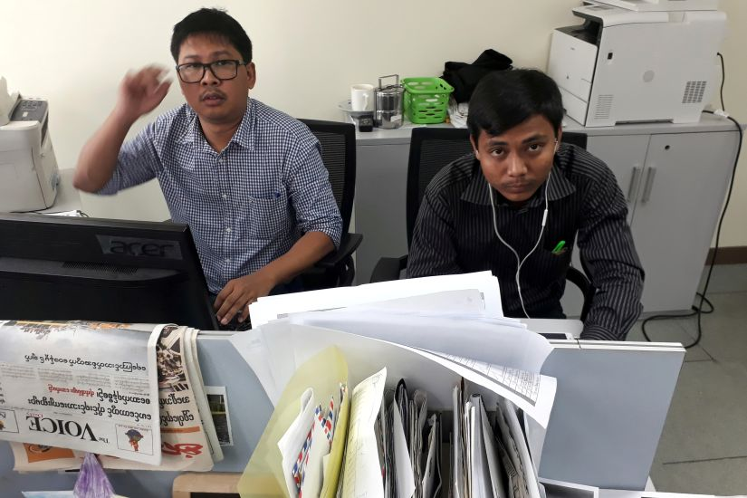 File image of Reuters journalists Wa Lone (L) and Kyaw Soe Oo, who are based in Myanmar, pose for a picture at the Reuters office in Yangon, Myanmar. Reuters