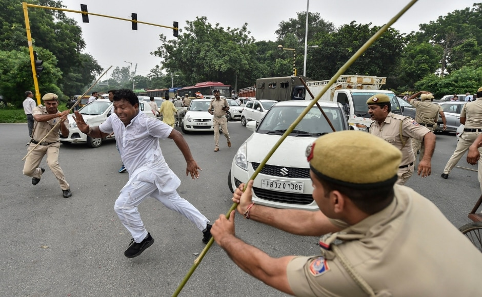 In New Delhi, policemen lathi-charged members of the Indian Youth Congress staging protests during the Bharat Bandh. PTI