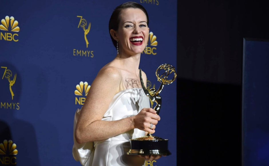 Claire Foy, winner of the award for outstanding lead actress in a drama series for The Crown poses in the press room at the Emmy Awards. The Associated Press/ Jordan Strauss