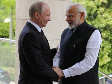 Russian President Vladimir Putin welcomes Prime Minister Narendra Modi during their meeting in Sochi in May. Reuters