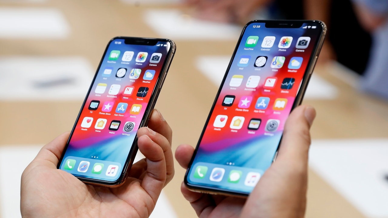 A man holds the newly released Apple iPhone XS and XS Max during a product demonstration. Image: Reuters