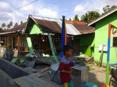 A house sits damaged in Donggala after earthquake hit central Sulawesi in Indonesia. Disaster Management Agency via AP