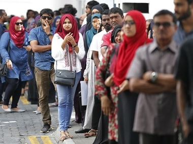 Maldivians queue up at a polling station in Male. AP