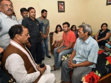 UP Deputy Chief Minister Keshav Prasad Maurya meets the wife of deceased Vivek Tiwari , Kalpana and other family members at their residence in Lucknow, Sunday. PTI