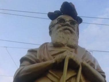A pair of shoes kept on top of Periyar's statue. ANI