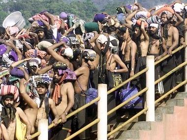 Pilgrims queue up outside the Sabarimala temple. Reuters