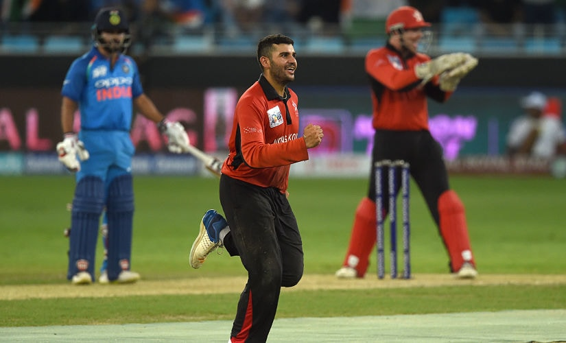 Hong Kong cricketer Kinchit Shah celebrates after dismissing Indian batsman Dinesh Karthik (unseen) during the one day international (ODI) Asia Cup cricket match between Hong Kong and India at the Dubai International Cricket Stadium in Dubai on September 18, 2018. (Photo by Ishara S. KODIKARA / AFP)