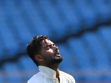 Indian cricketer Rishabh Pant reacts after getting out during the second day's play of the first Test cricket match between India and West Indies at the Saurashtra Cricket Association stadium in Rajkot on October 5, 2018. / AFP PHOTO / INDRANIL MUKHERJEE / ----IMAGE RESTRICTED TO EDITORIAL USE - STRICTLY NO COMMERCIAL USE----- / GETTYOUT