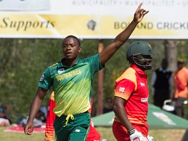 South Africa's bowler Kagiso Rabada (L) celebrates after dismissing Zimbabwe's Hamilton Masakadza (R) during the third One Day International cricket match between South Africa and Zimbabwe on October 6, 2018, at Boladnd Park, in Paarl, about 60 kilometres from Cape Town. (Photo by RODGER BOSCH / AFP)