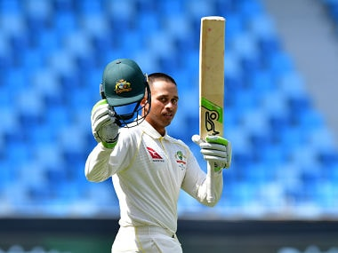 Australian cricketer Usman Khawaja celebrates a century during day five of the first Test cricket match in the series between Australia and Pakistan at the Dubai International Stadium in Dubai on October 11, 2018. (Photo by GIUSEPPE CACACE / AFP)