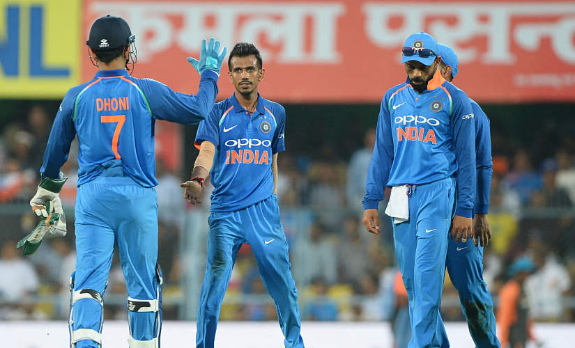 Indian bowler Yuzvendra Chahal (C) celebrates after he dismissed West Indies batsman and team captain Jason Holder during the first one day international (ODI) cricket match between India and West Indies at Barsapara Cricket Stadium in Guwahati on October 21, 2018. (Photo by SAJJAD HUSSAIN / AFP) / ----IMAGE RESTRICTED TO EDITORIAL USE - STRICTLY NO COMMERCIAL USE----- / GETTYOUT