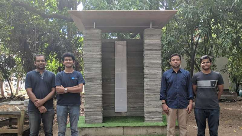The IITM Civil engineering students and alumni involved in developing the 3D printing technology. Image courtesy: IIT Madras