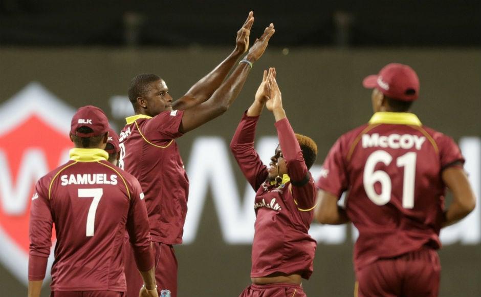 Jason Holder celebrates the dismissal of India wicket-keeper-batsman MS Dhoni. AP