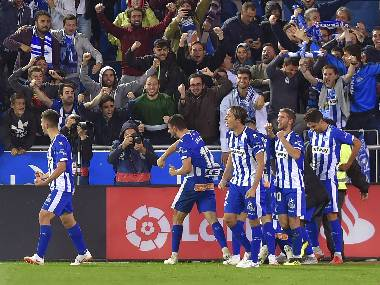 Deportivo Alaves' players celebrate after scoring the winner against Real Madrid. AFP