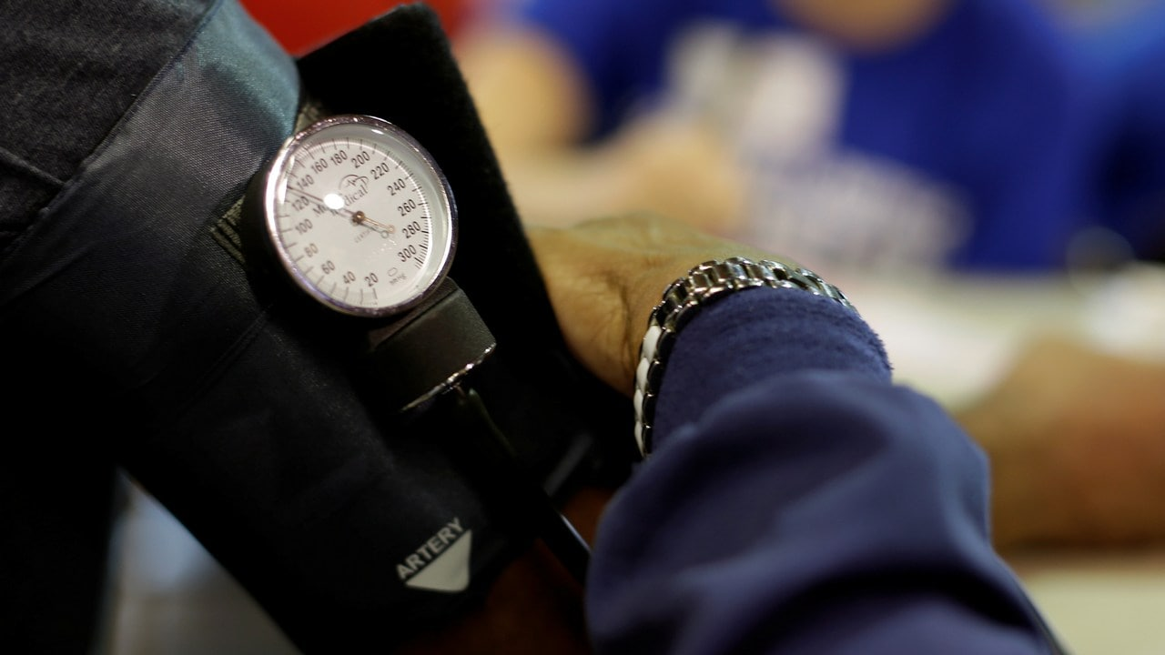 A man has his blood pressure checked at a clinic. Image: Reuters