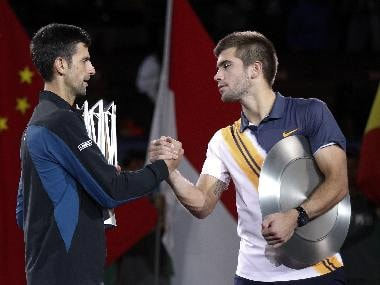 Novak Djokovic (left) shakes hands with Borna Coric after the Shanghai Masters final. AP Photo