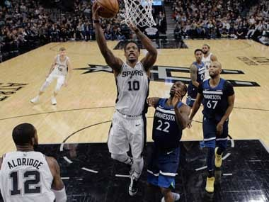 San Antonio Spurs guard DeMar DeRozan scores past Minnesota Timberwolves guard Andrew Wiggins. AP