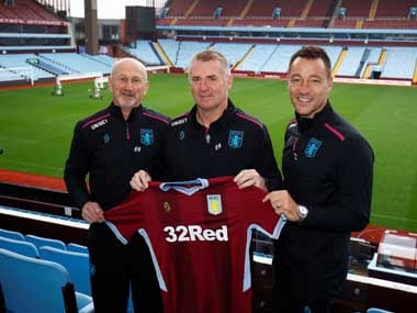 Aston Villa manager Dean Smith (C) alongside assistant managers Richard O'Kelly (L) and John Terry (R). Reuters
