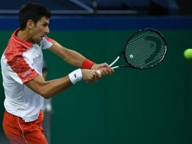 Novak Djokovic returns to Alexander Zverev during their men's singles semi-finals match at the Shanghai Masters. AFP