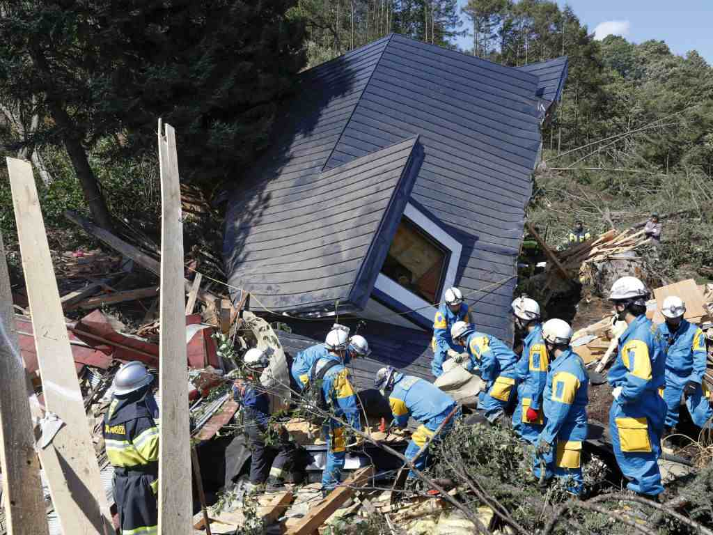 Rescue workers search for survivors from a house damaged by a landslide caused by an earthquake in Atsuma town, Hokkaido, Japan, in this photo taken by Kyodo. Reuters.