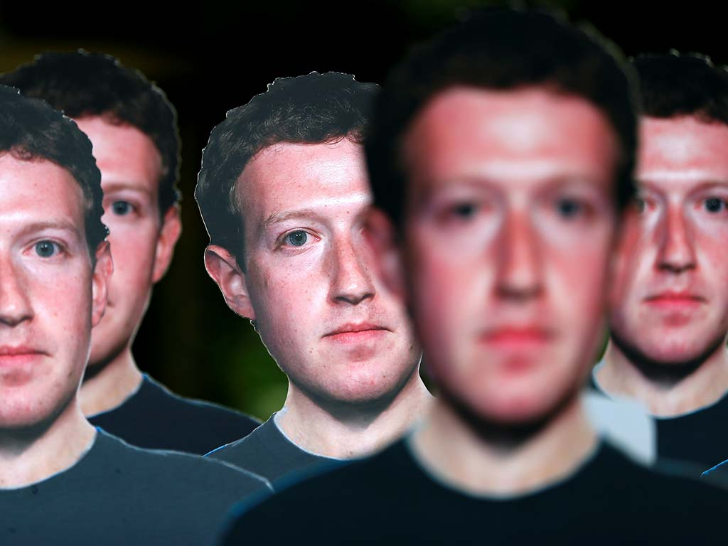 Cardboard cutouts of Facebook CEO Mark Zuckerberg. Image: Reuters