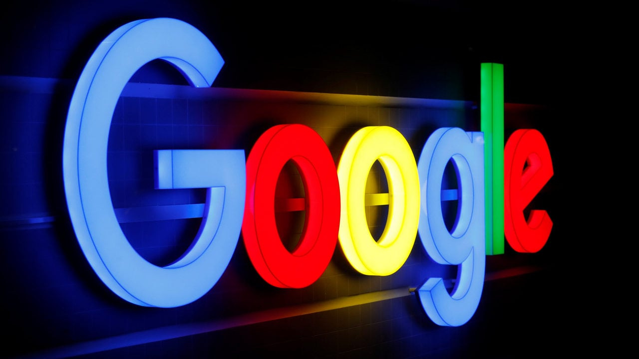 An illuminated Google logo is seen inside an office building in Zurich September 5, 2018. REUTERS/Arnd WIegmann - RC1F060A01D0