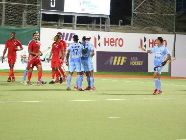 India celebrate a goal against Oman. Image courtesy: Twitter @TheHockeyIndia
