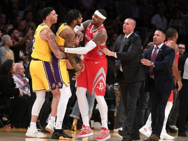 Los Angeles Lakers guard Lonzo Ball (2) and Houston Rockets forward Carmelo Anthony (7) restrain Los Angeles Lakers forward Brandon Ingram (14) after a fight in the fourth quarter of the game at Staples Center. Reuters
