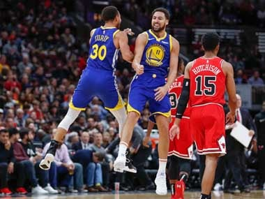 Klay Thompson celebrates with teammate Stephen Curry, whose record Thompson broke with his fourteenth 3-pointer. AP