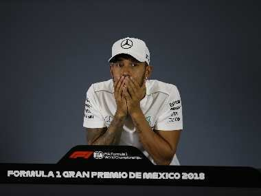 Mexican Grand Prix: Lewis Hamilton joins Juan Manuel Fangio in history books with surreal fifth world championship