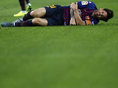 Barcelona's Lionel Messi injures his arm during the LaLiga match against Sevilla at the Camp Nou. AP Photo